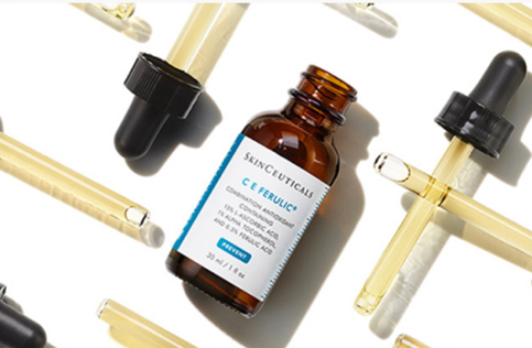Open bottle of SkinCeuticals CE Ferulic surrounded by many Bottle Droppers.