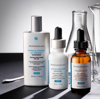 Samples of SkinCeuticals products: Physical Fusion UV Defense, Discoloration Defense, and Phloretin CF.